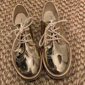 Zara kids gold wing tip shoes